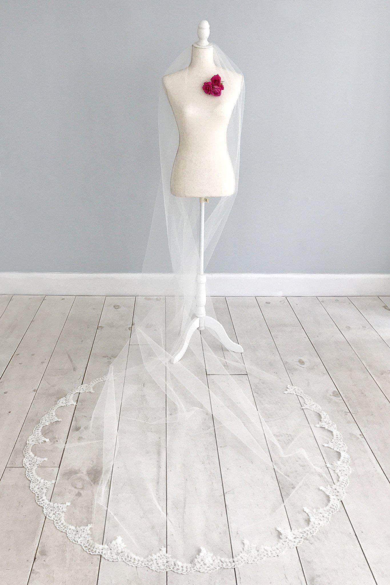 Semi edge wedding veil with lace around train