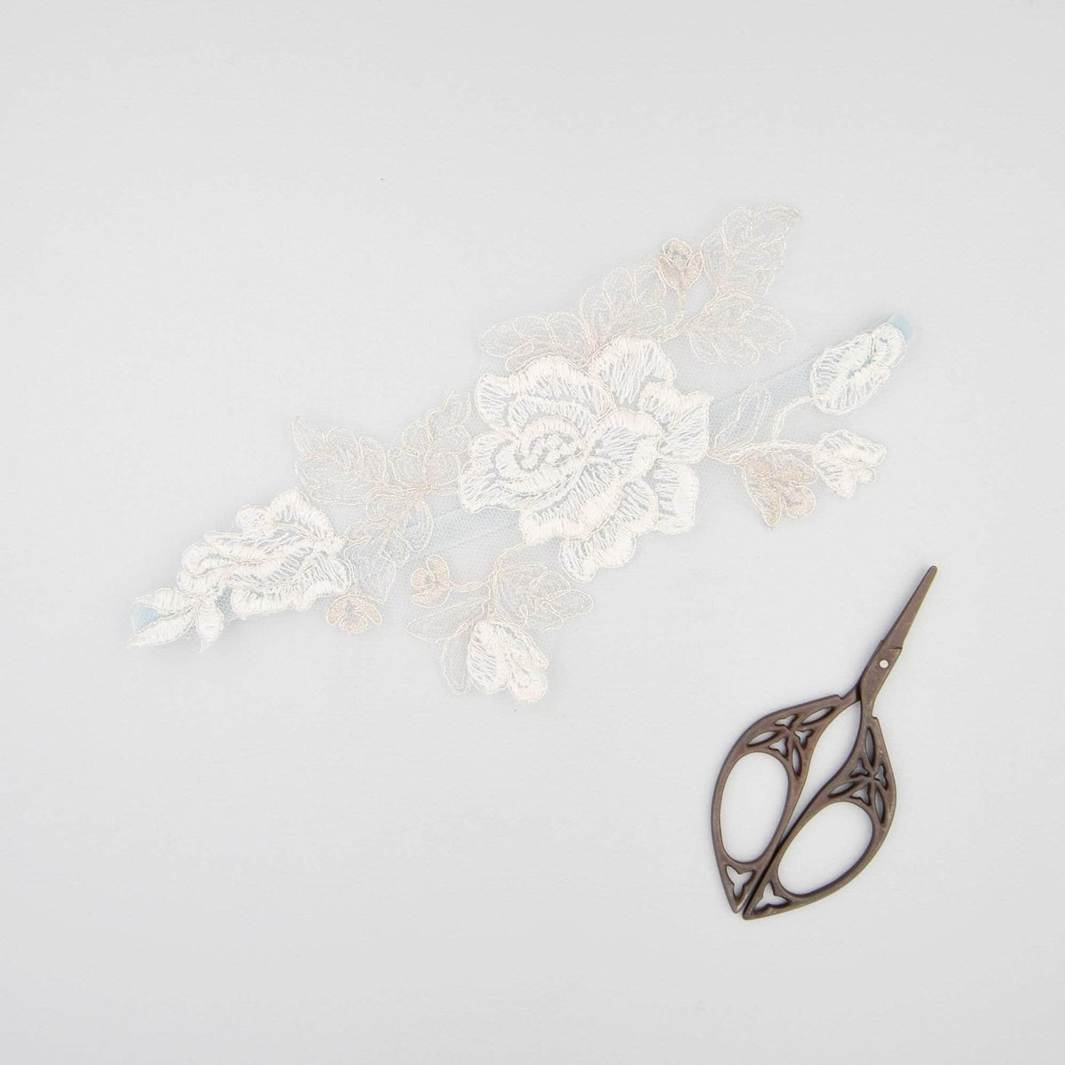 Wedding Garter 'Something blue' silver and ivory lace motif garter - 'Amara'