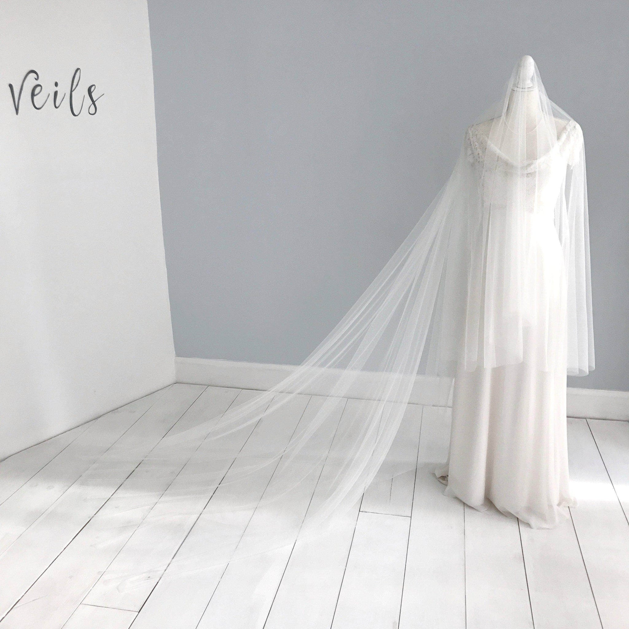 39 Stunning Wedding Veil Headpiece Ideas For Your 2016: Cut Edge Silk Style Wedding Veil With Extra Long Blusher