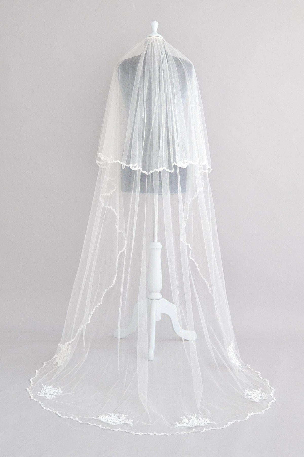 crisp silk two tier wedding veil with lace motifs