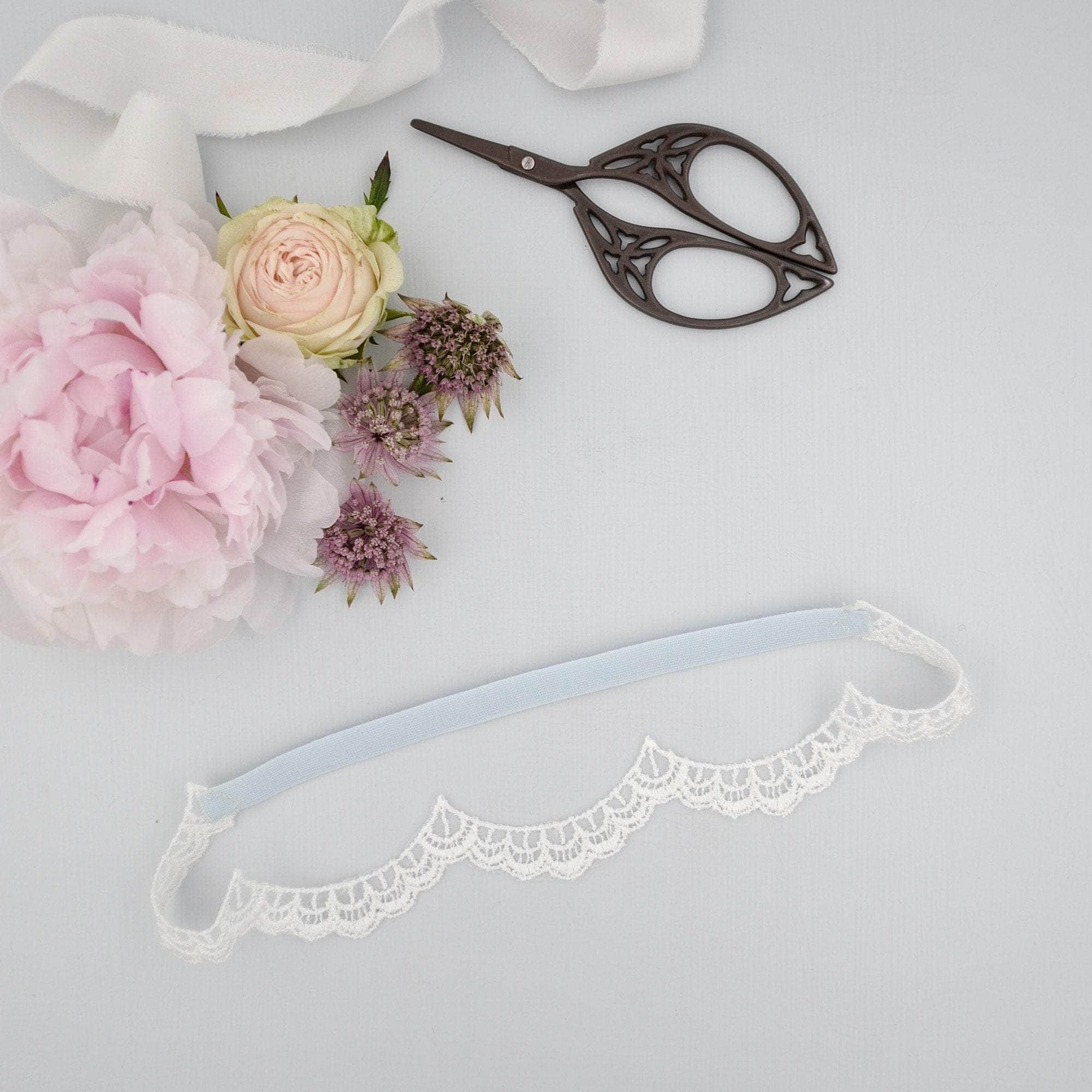 'Something blue' and delicate scalloped lace garter - 'Ada' - Britten Weddings