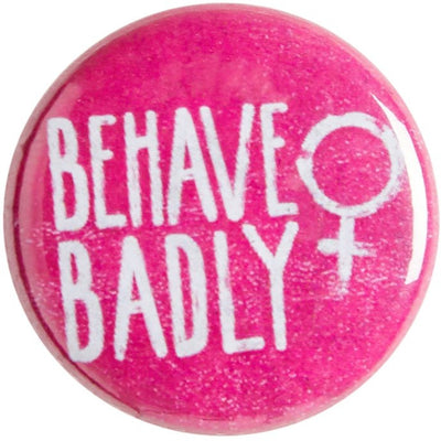 Pink pin badge with Behave Badly motto and female symbol. From the Rising Tide exhibition at Cambridge University Library, brought to you by CuratingCambridge.com