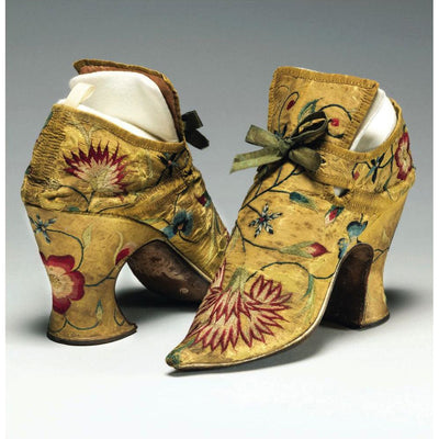 Square greeting card - pair of yellow silk high heeled shoes, laced with green ribbon in a bow and decorated with flowers in red, white, and blue. From the collection of The Fitzwilliam Museum, brought to you by CuratingCambridge.com