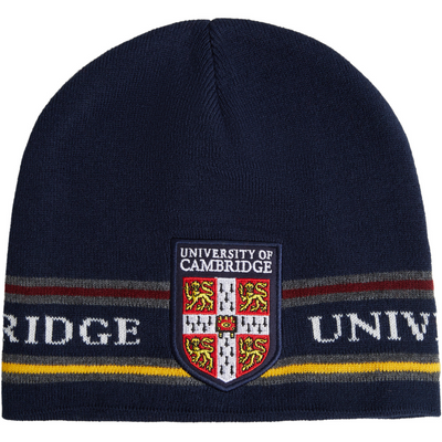 Beanie hat in navy blue, with fine stripe design and University of Cambridge shield. Official merchandise brought to you by CuratingCambridge.com