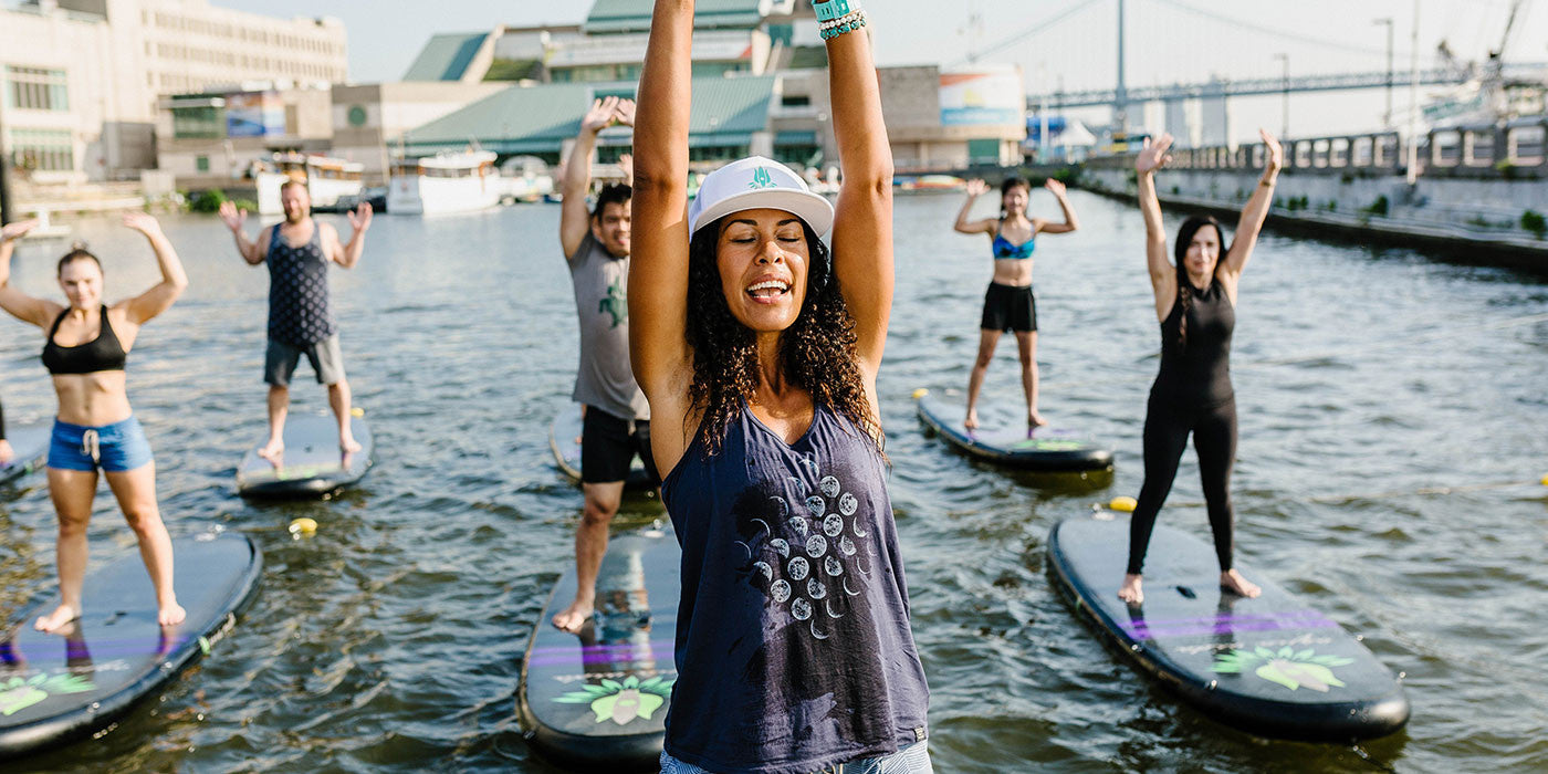 Meet the sup instructor who picks up trash as she paddles