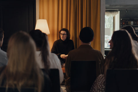 Professional writer speaking to a group of people