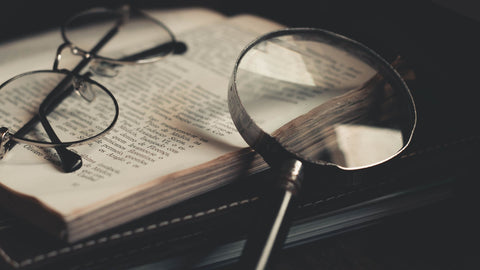Magnifying glass, glasses, book.