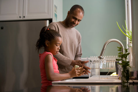 See the faces of loved ones with Vision Buddy! A father and his wife by the kitchen sink.