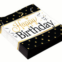 happy birthday luncheon napkins black background with gold dots and streamers with confetti