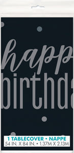 black and grey plastic tablecover with a happy birthday printed edges