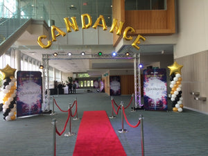 large foil balloon letters spelling out Candance