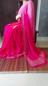Copy of Pink Peach And Rani Pure Chiffon Handwork Saree.