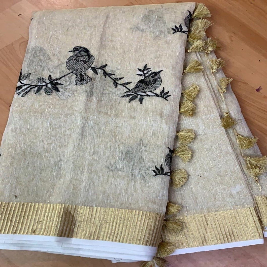 Buy Light Color Linen Tissue Embroidred Saree