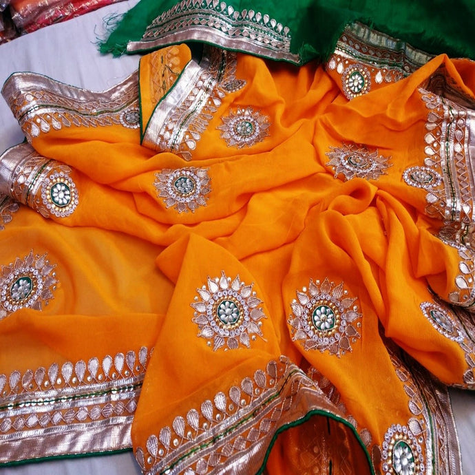 Orange and green saree with gota patti work