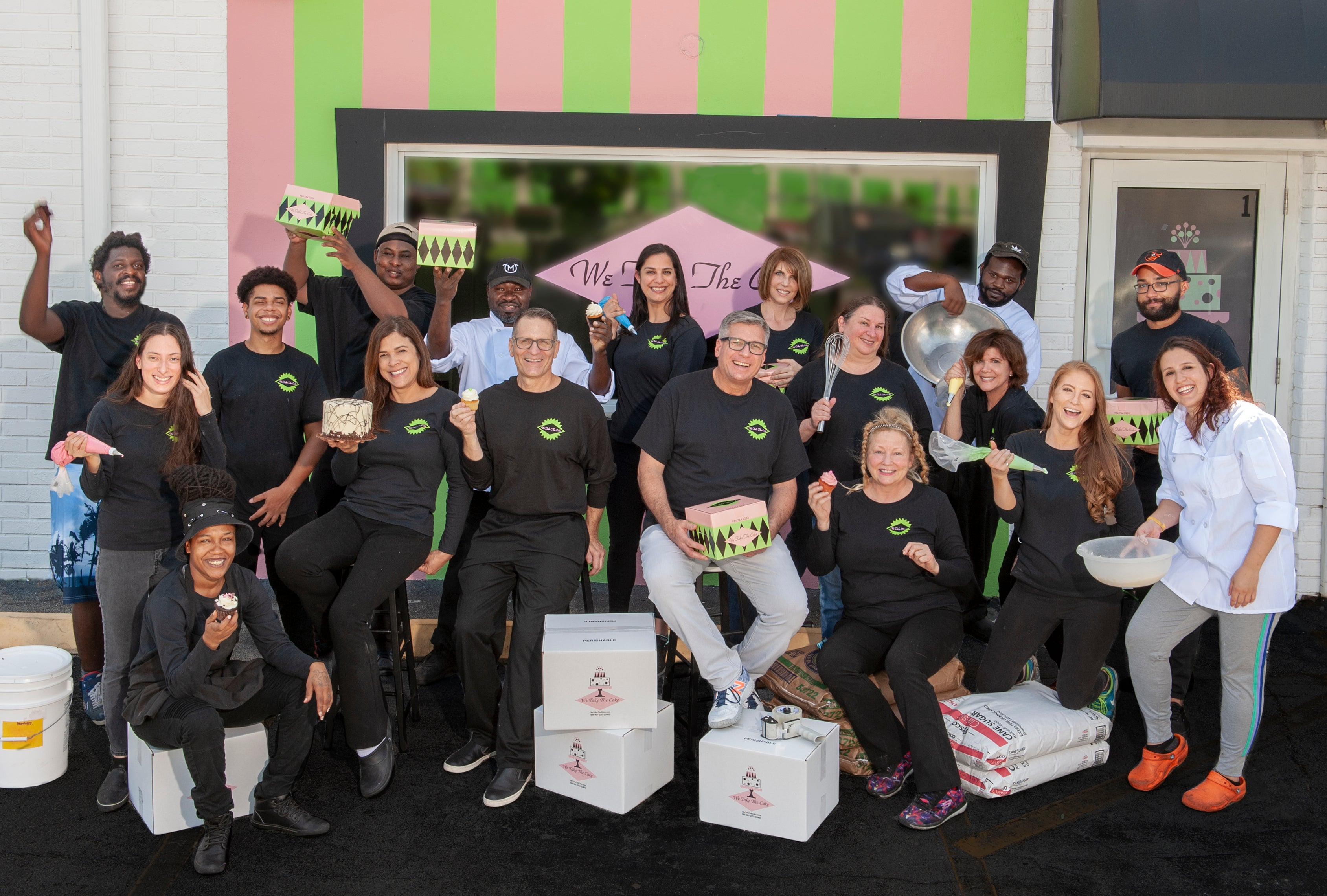 We Take the Cake Full staff photo in front of their local bakery in Florida.