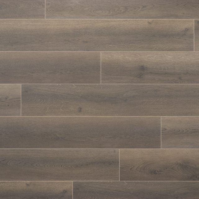 Evoke Laminate Promenade Oscar, a wide plank, brushed, low gloss laminate, available at Alberta Hardwood Flooring.
