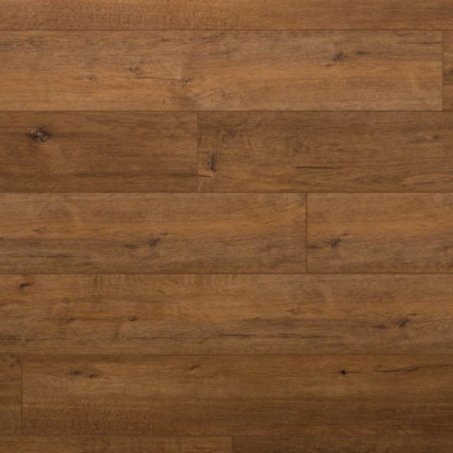 Evoke VCC Vigor Grant, a brown oak, embossed, wide plank vinyl in a low gloss finish.