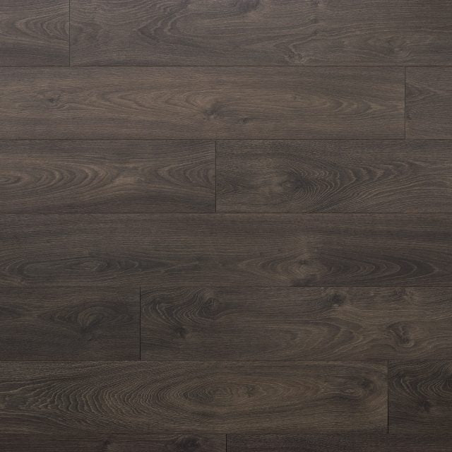 Evoke Laminate Promenade Noah, a wide plank, brushed, low gloss laminate, available at Alberta Hardwood Flooring.