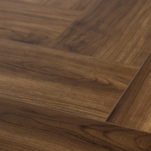 Evoke VCC Vivid Herringbone Andrew, a brown, embossed, wide plank vinyl in a low gloss finish.