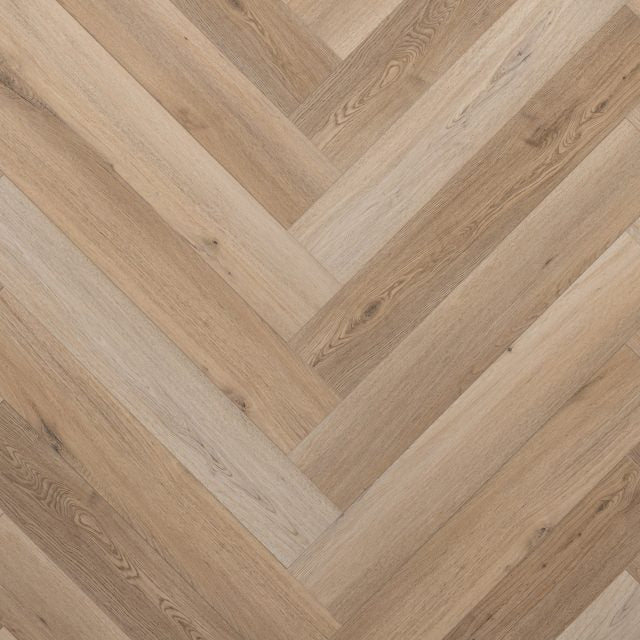 Evoke VCC Vivid Herringbone Donna, a light, embossed, wide plank vinyl in a low gloss finish