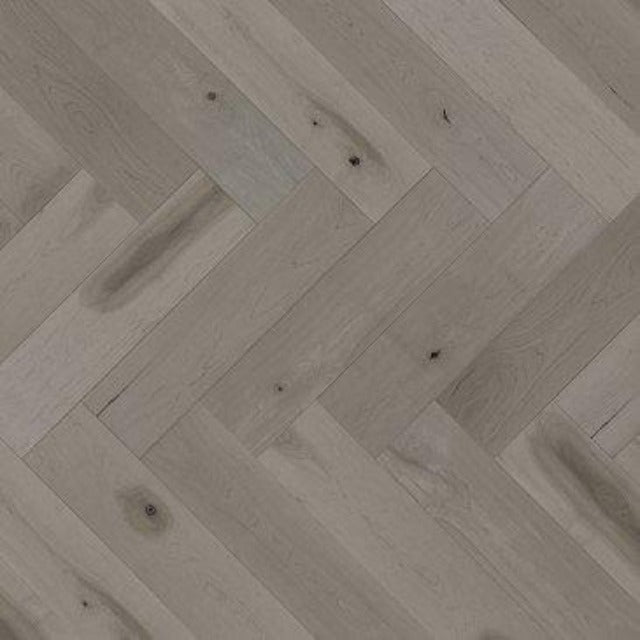 Mirage Maple Grey Drizzle Character Smooth Herringbone Duramatt Wide plank with a matte finish, in a maple, available at Alberta Hardwood Flooring.
