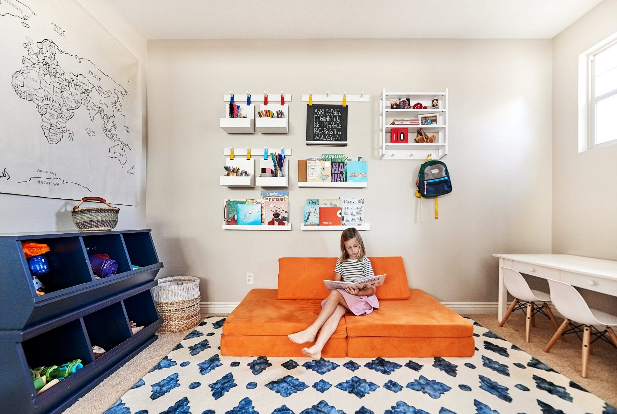 A child reading on the couch in the playroom