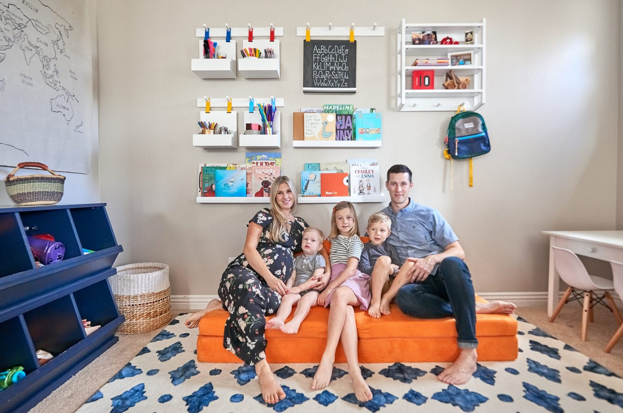 Andrea and Brian's family sitting in the new playroom