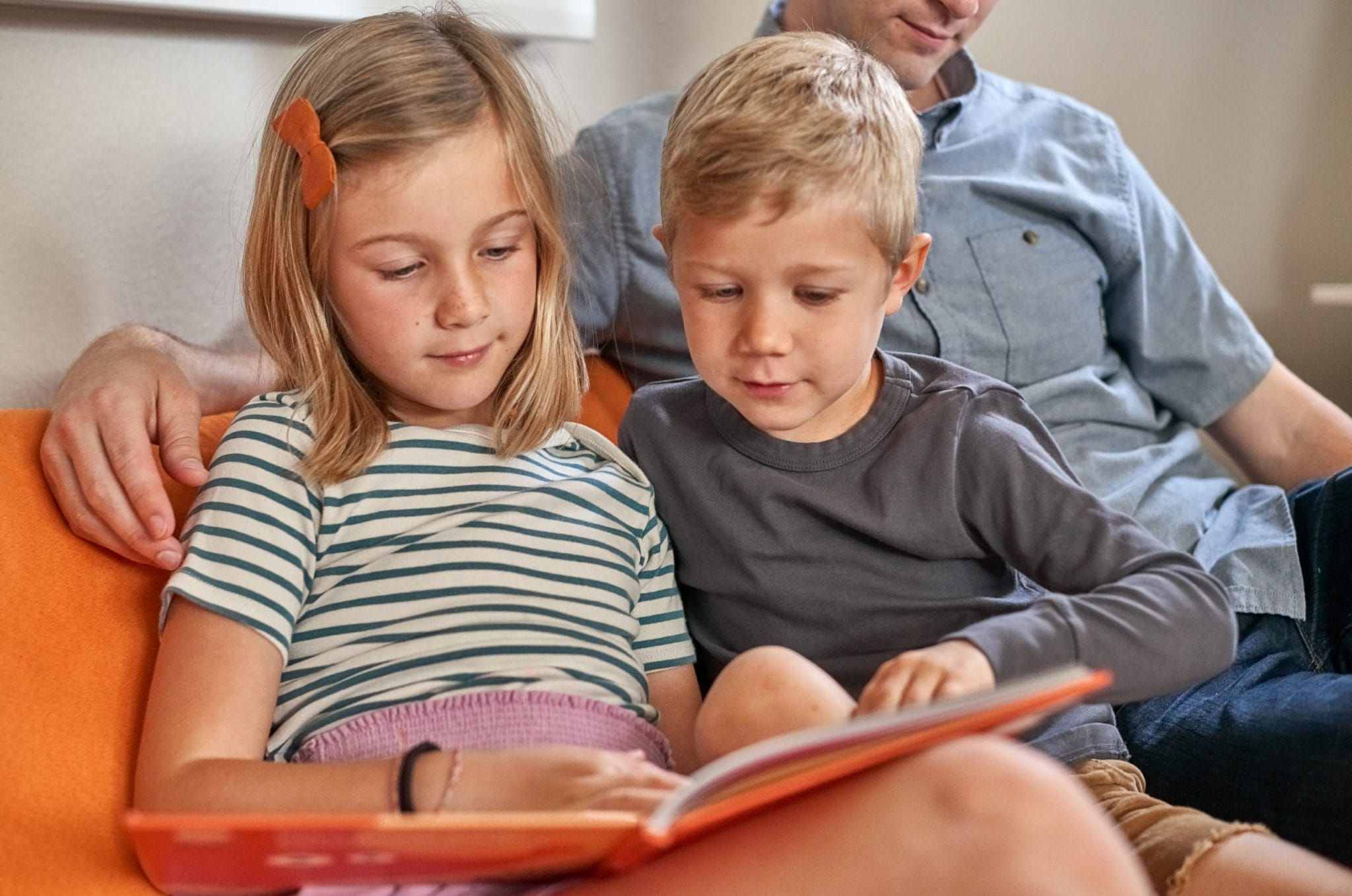 Closeup of the kids reading in the new playroom