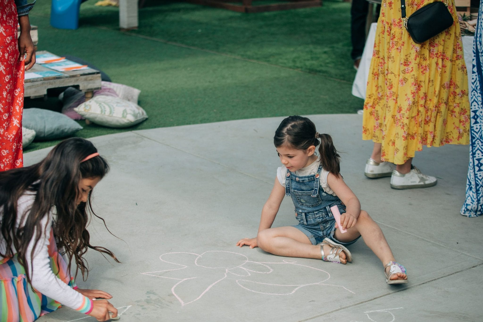 Kids playing with chalk at the party