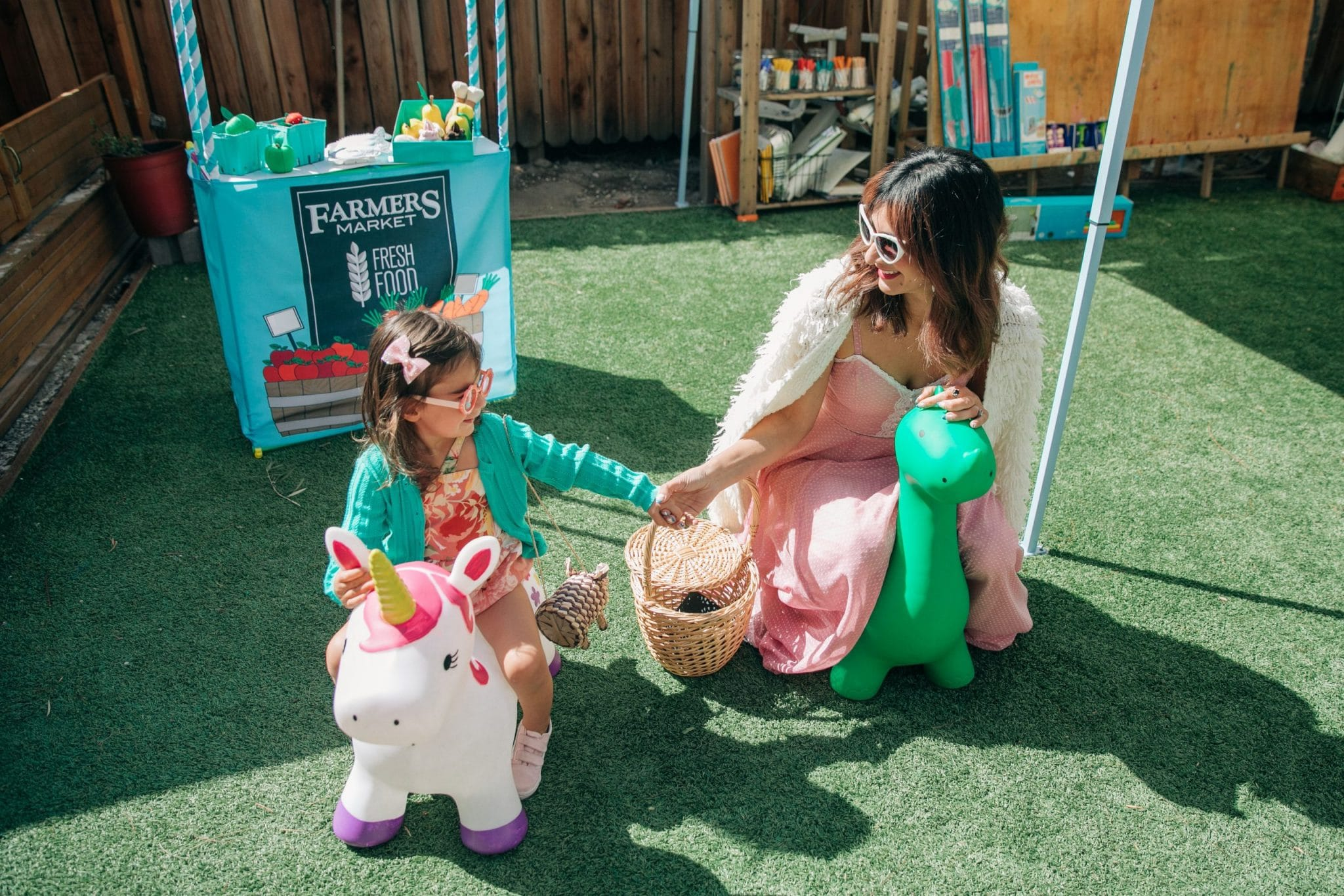 A child on a unicorn at the party