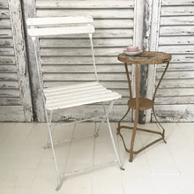 Folding white French cafe chair