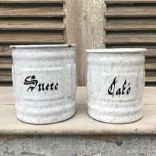 Pair of enamel storage canisters