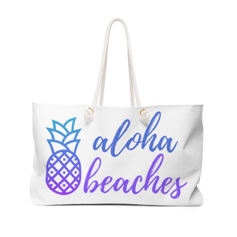 White tote bag with blue-purple ombre pineapple and Aloha Beaches in script