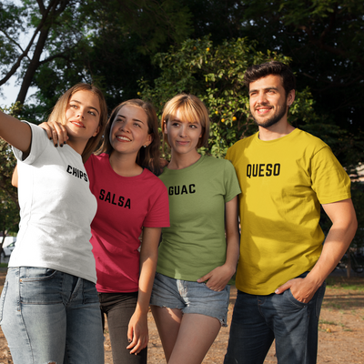 Group of four friends taking a selfie outside while wearing shirts that say Chips, Salsa, Guac and Queso.