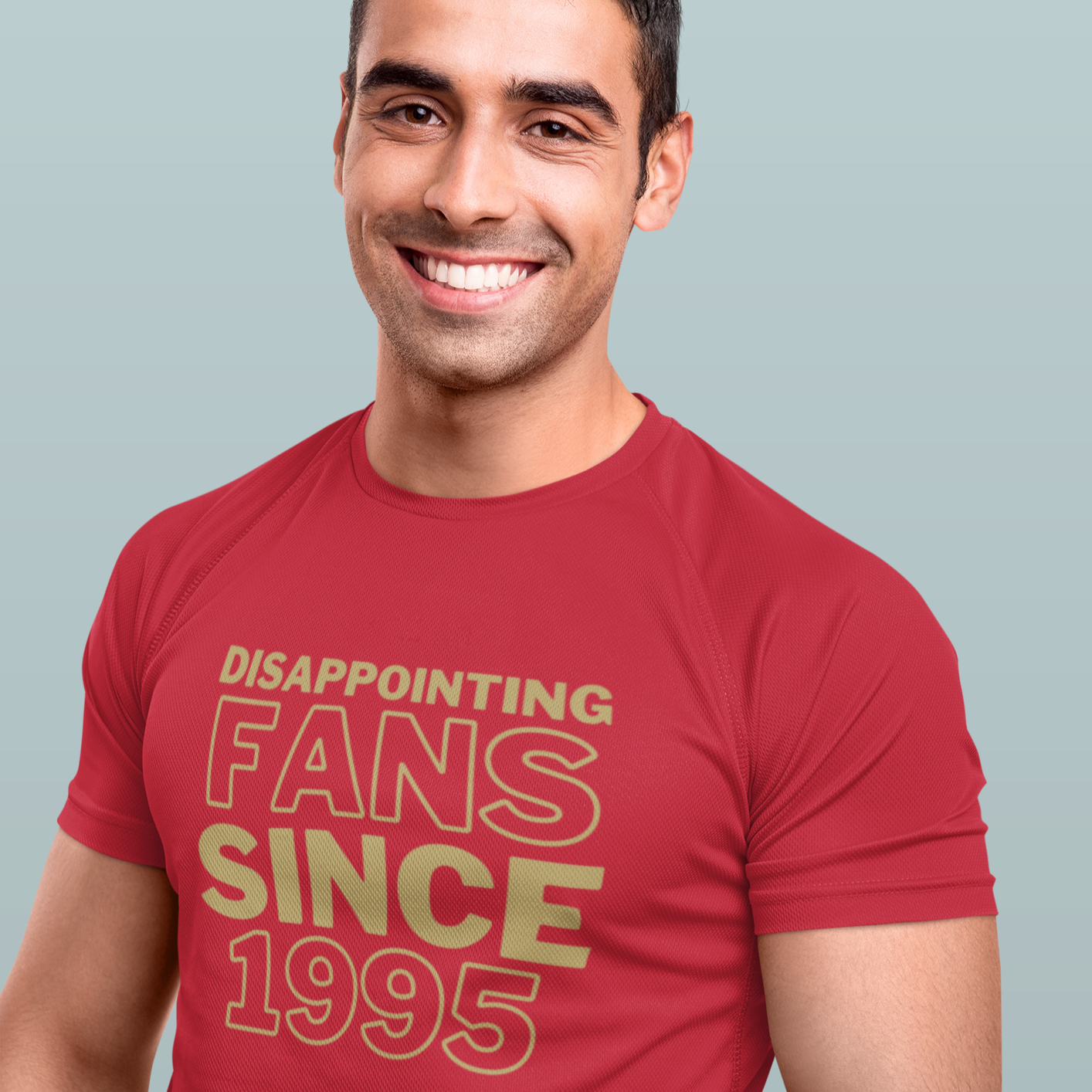 Smiling tall dark and handsome man with a red t-shirt