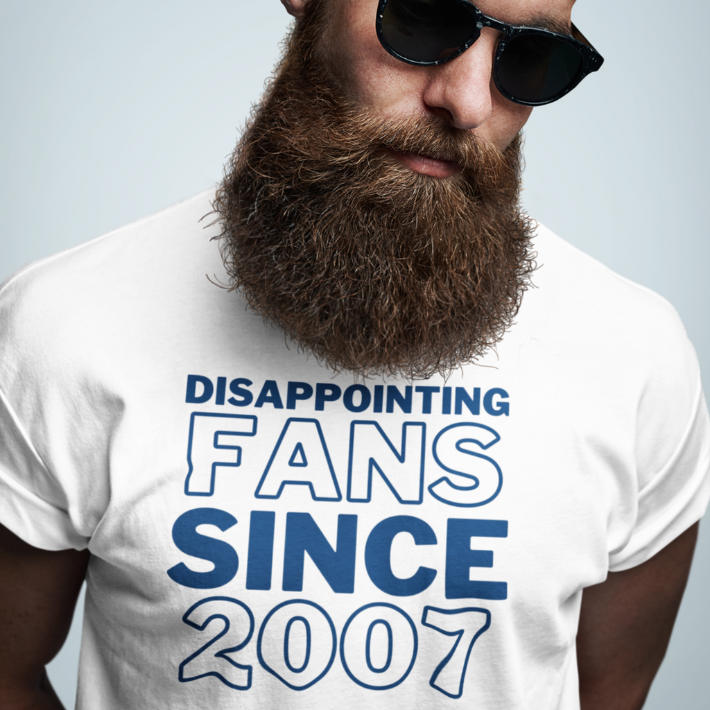 Man with big brown beard and sunglasses glancing down to the side a bit