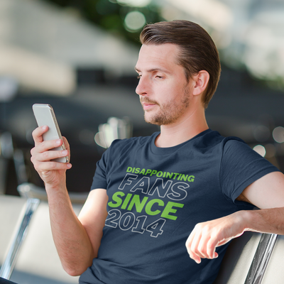 Man sitting down looking at his phone