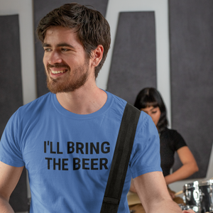 Handsome bearded man looking off to the side wearing an I'll Bring The Beer shirt