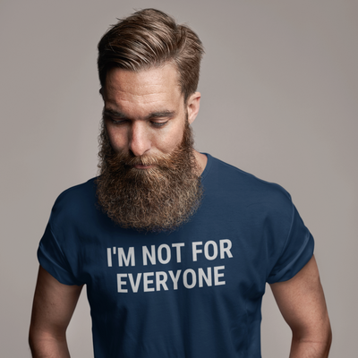 Man with a long beard looking down and wearing a shirt that says I'm Not For Everyone