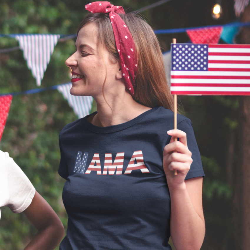 Smiling woman holding an American flag looks off to the side and smiles