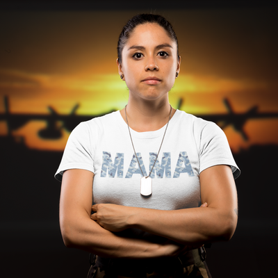 Serious military woman at sunset with cargo plane in background wearing a dog tag and mama in blue camo shirt