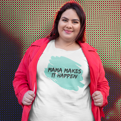 Brunette woman wearing a red hoodie standing in front of a light up wall with a shirt that says Mama Makes It Happen