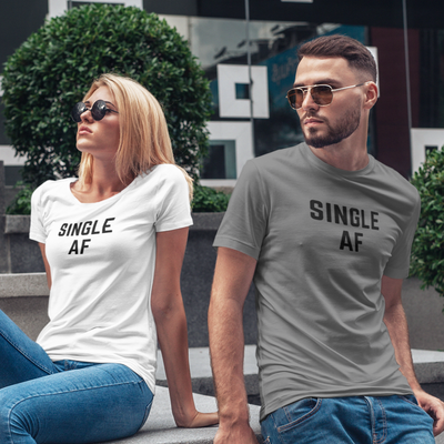 Cool looking man and woman lounging outside of a shopping area wearing Single AF shirts