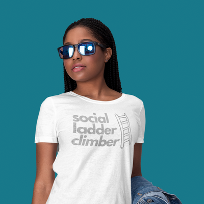Woman wearing sunglasses and looking cool while wearing a Social Ladder Climber shirt and holding a jean jacket on her arm