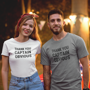 Attractive man/woman couple each wearing Thank You Captain Obvious shirts at dusk