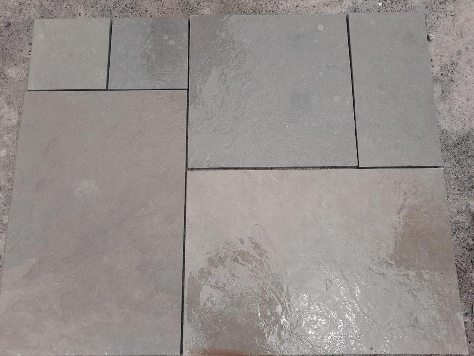 dove grey limestone paving wet