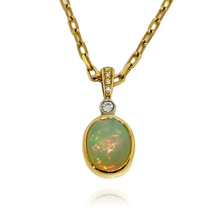 Mark Areias Jewelers Jewellery & Watches Natural Ethiopian Oval Opal & Diamond Pendant 14K Yellow Gold 9x11mm 2.44 Carat