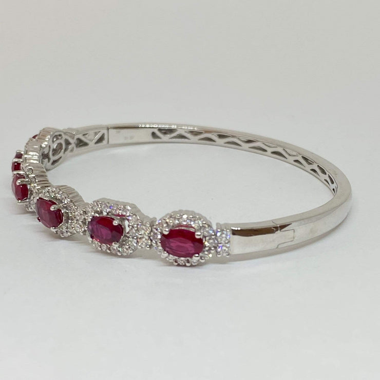 Mark Areias Jewelers Jewellery & Watches Oval Ruby and Diamond Halo Bangle Bracelet 14KW