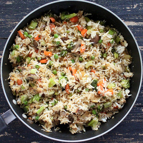 cauliflower fried rice, with carrots, celery, onion, mushrooms (2 size options)