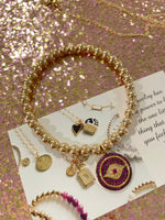 Load image into Gallery viewer, Pink Evil Eye Bracelet with Gold Beads